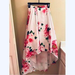 White floral skirt.
